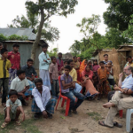 Firdaus-Kharas-talking-with-villagers-in-Bangladesh.png